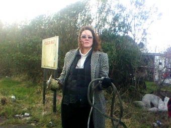 Suzanne Kelly with rubbish at the entrance and dangerous industrial waste from the gorse clearance mid March 2012.