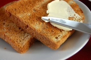 2633672-spreading-butter-with-a-knife-on-a-toast