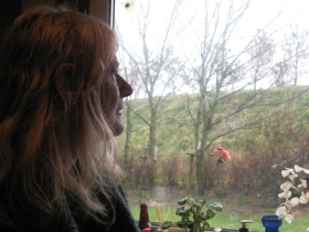Susan Munro Looking Out Of Her Kitchen At A Bund Photo - March 2013