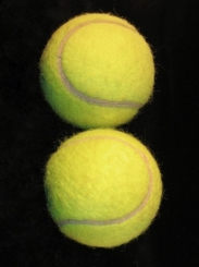TENNIS BALLS ON BLACK