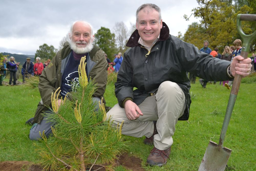 Alan_&_Richard_Lochhead_with_planted_Scots_pine_(small)