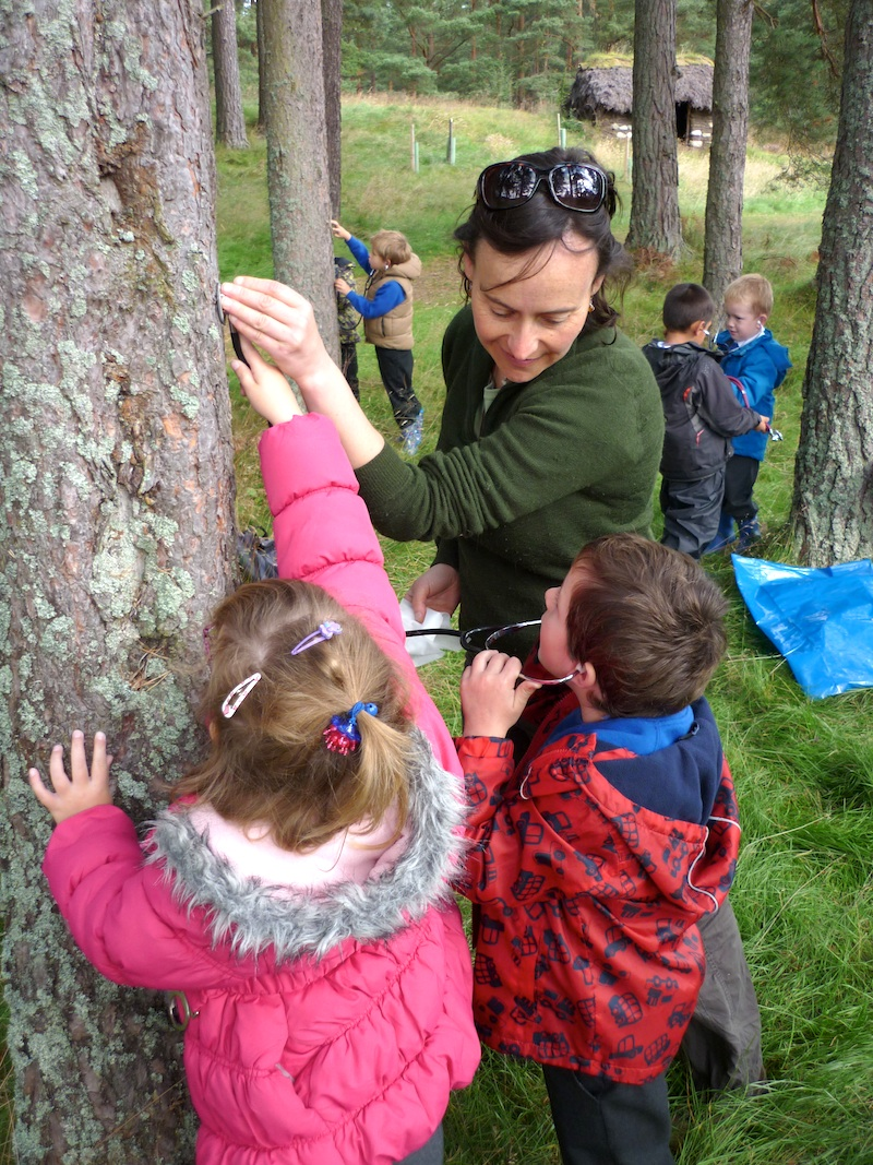 Jennie and kids stethoscope – Jennie showing children the 'heart' of a tree.