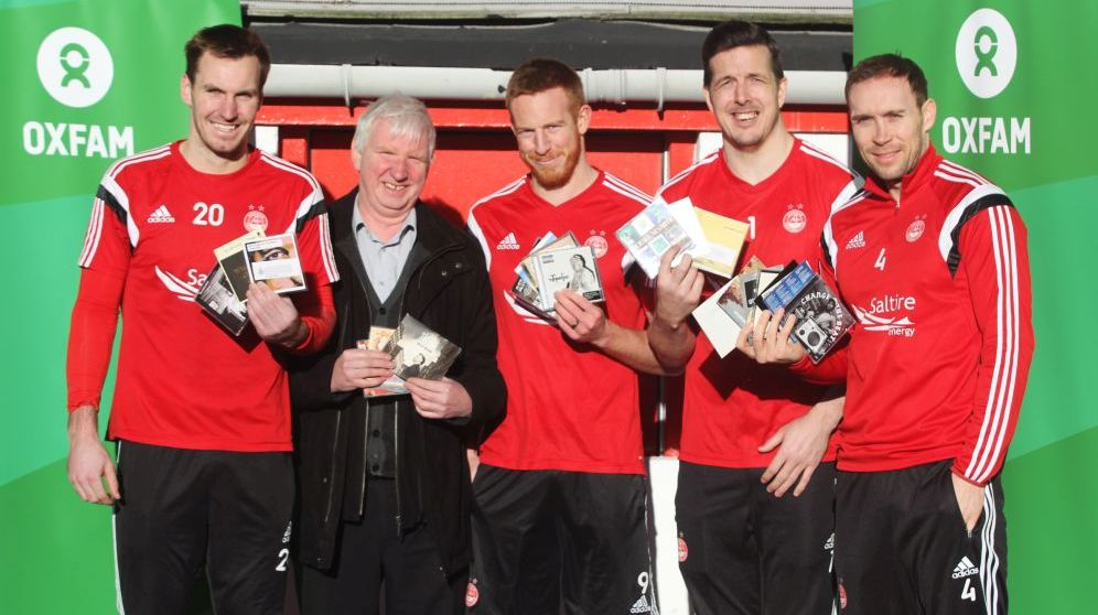 Oxfam Area Manager Peter Roy, who is leading the initiative, is pictured with Dons players Scott Brown, Adam Rooney, Jamie Langfield and Russell Anderson 2