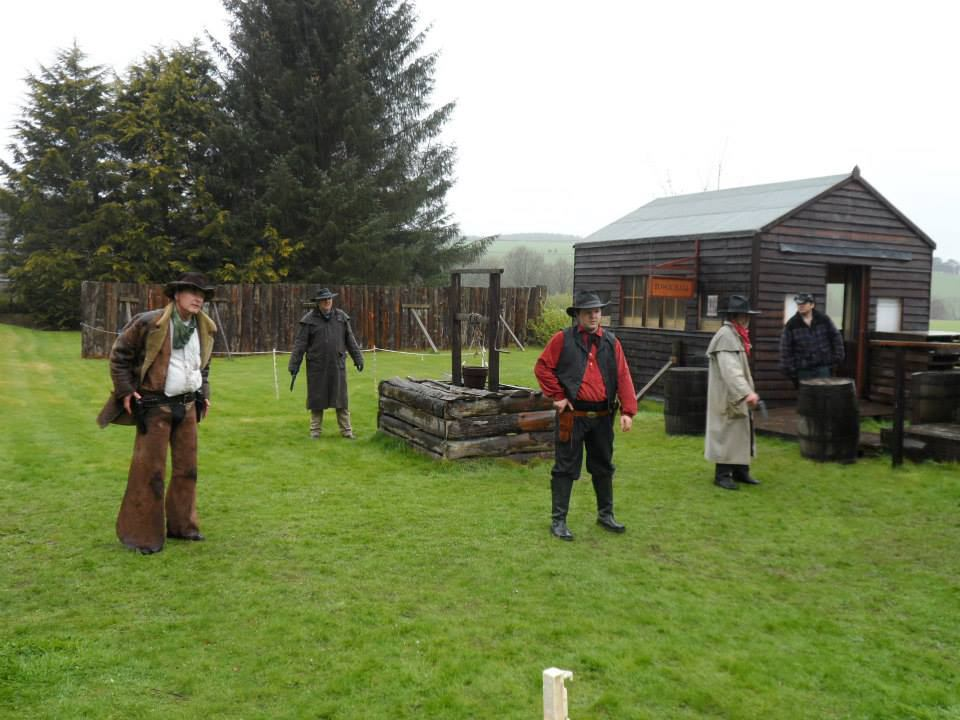 Tranquility Wild West Town reenactment the bad guys get ready to draw by Suzanne Kelly