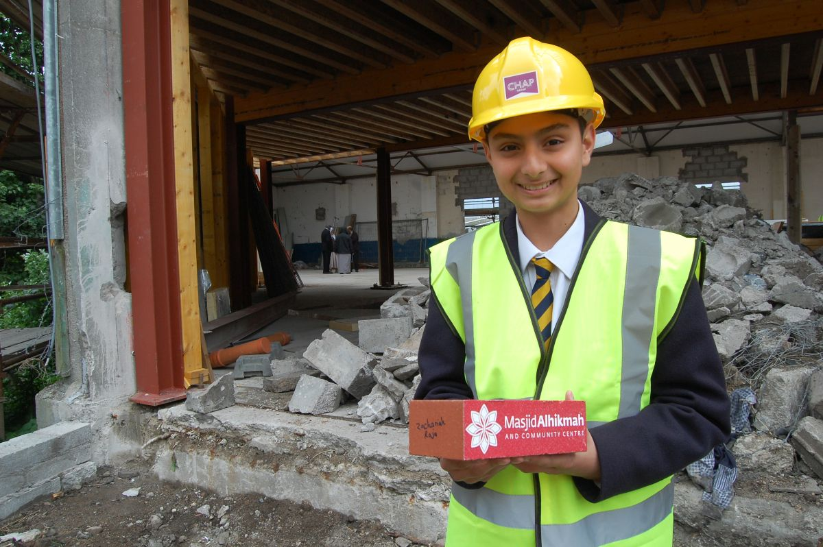 Zachariah Raja with the brick he laid as part of the ongoing Masjid Alhikmah project in Aberdeen. (3)
