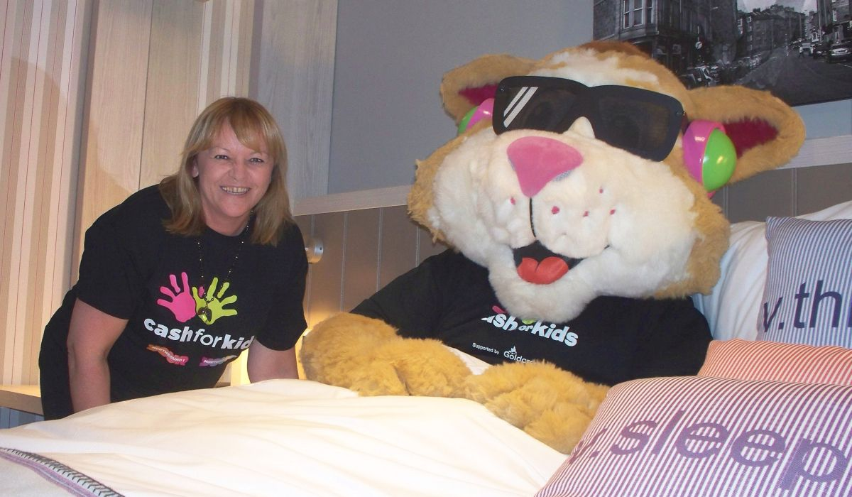 Michele Binnie and Courage the Cat launch the Scottish Bed Making Championship