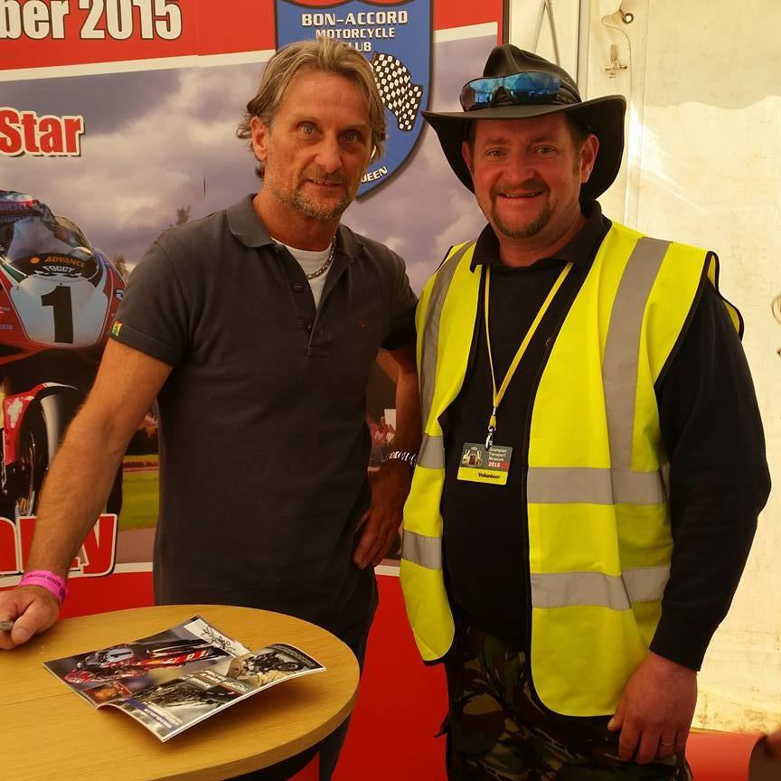 Museum volunteer Symon Hollingdale with star guest Carl Fogarty