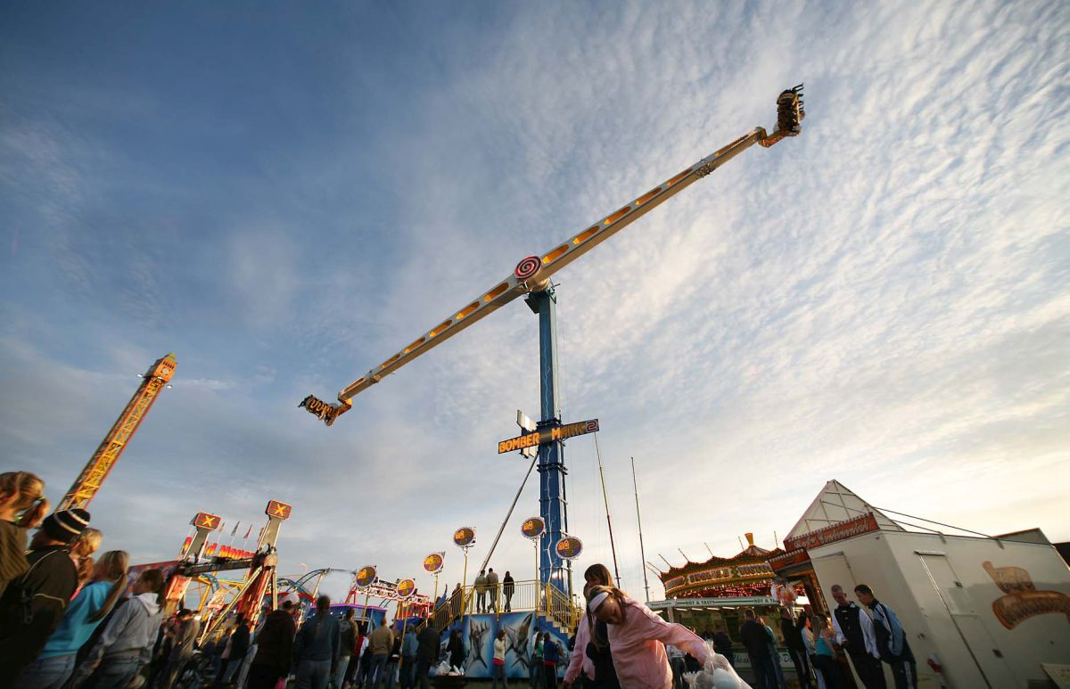 The world's largest mobile thrill ride, Bomber Mac 2, reaches speads of up to 60 miles and hour at 55 metres tall at The Hoppings, Newcastle's legendary fair on the Town Moor. PHOTOGRAPH: Dirk van der Werff / AQphotos.com