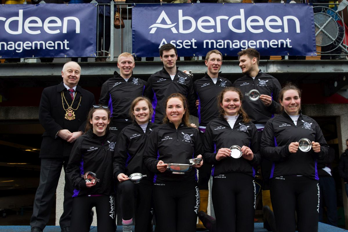 Picture issued for free use by tricker pr on behalf of aberdeen asset management 2016 aberdeen boat race between robert gordon university (black/white) and aberdeen university (blue/yellow) on the river dee .... Pictured: Lord Provost George Adam with RGU after winning the 2016 race photo: Ross Johnston/Newsline Media.
