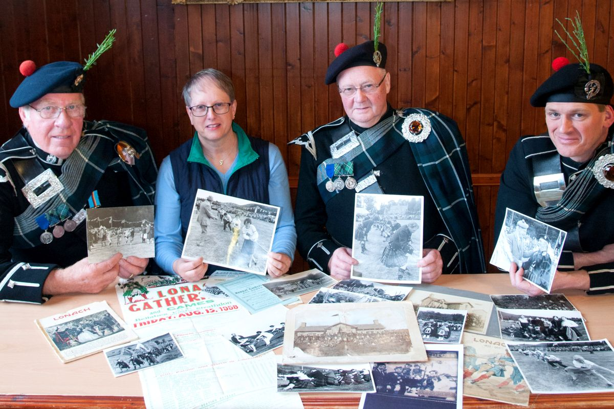 1. Looking through some of the Lonach archive (L to R) George Thomson, Jennifer Stewart, Willie Coutts and Scott Anderson