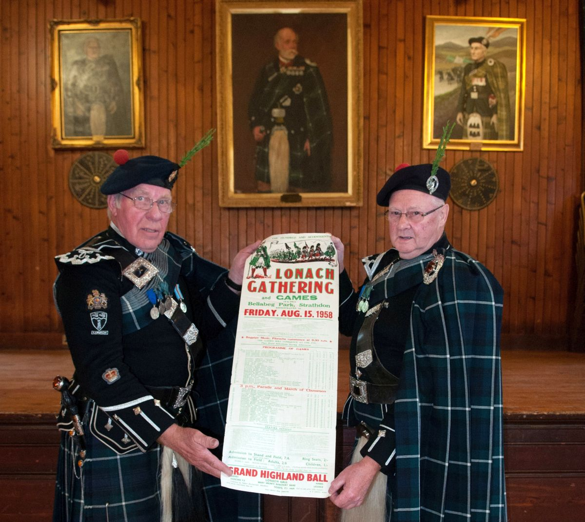 2. Lonach Highlanders (L to R) George Thomson and Willie Coutts with a poster promoting the 1958 Lonach Highland Gathering and Games