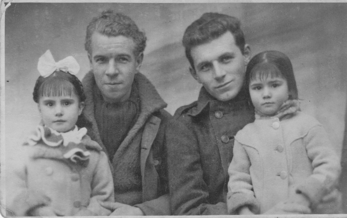 John Londragan (left) photographed in Spain 1937 with American Brigader, Peter Frye and Juan's two daughters.