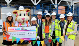 Property and construction associations build Cash for Kids - (L to R holding the cheque) Michelle Ferguson, Courage the Cat and Michelle Forth
